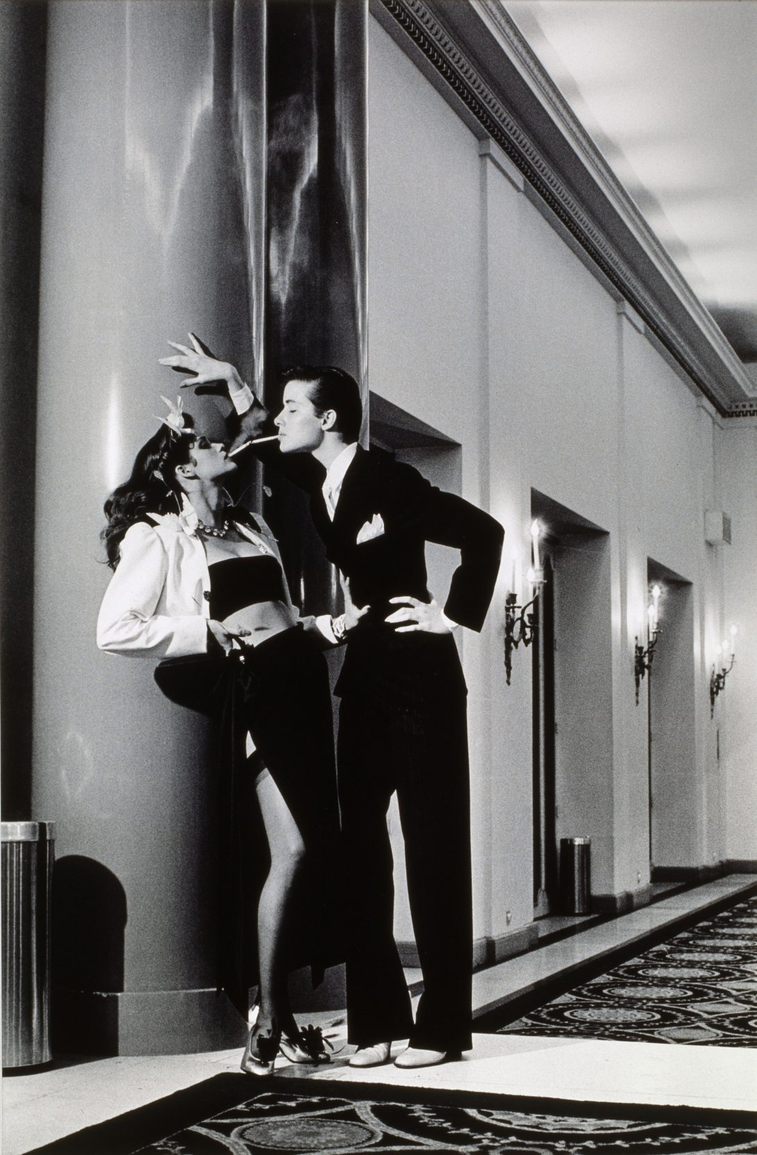 Vogue, Paris, Yves Saint Laurent - Woman into Man, lighting a ciga by Helmut Newton