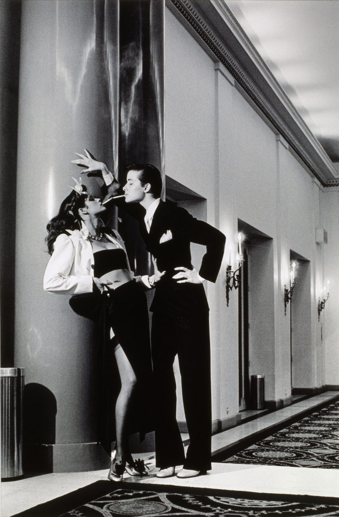 Vogue, Paris, Yves Saint Laurent - Woman into Man, lighting a ciga by Helmut Newton